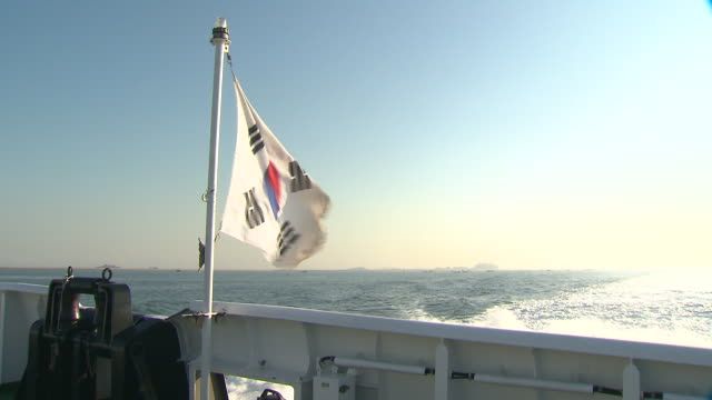 shot of south korean flag on the boat sailing and seascape - south korean flag stock videos & royalty-free footage