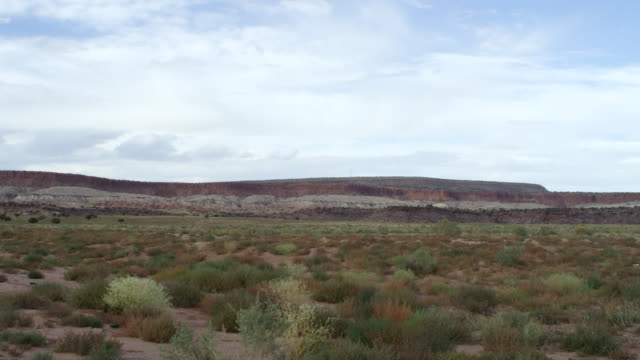 ws shot of southerwestern usa landscape with mesa and clouds / new mexico, united states - mesa stock videos and b-roll footage