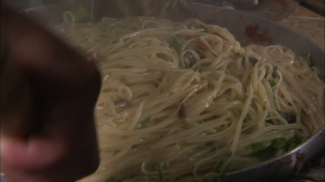 stockvideo's en b-roll-footage met shot of spaghetti being cooked with tuna in sicily, italy - spaghetti
