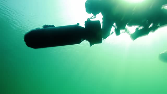 ms shot of special operation forces combat diver with dvp diver propulsion vehicle during underwater operation at ocean surface / open water - surveillance stock videos & royalty-free footage