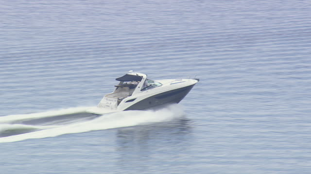ms aerial ts shot of speed boat / sao paulo, brazil - speed boat stock videos & royalty-free footage
