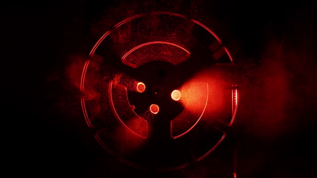 MS Shot of Spinning reel backlit with red light / London, United Kingdom