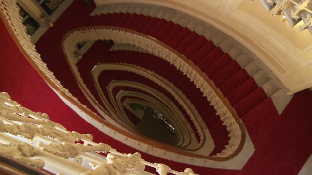 ms pan shot of spiral staircase of bristol hotel / genoa, liguria, italie - spiral staircase stock videos & royalty-free footage