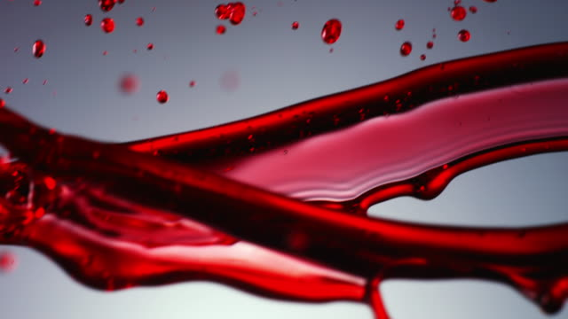 vídeos de stock e filmes b-roll de cu slo mo shot of splash of red liquid falling / united kingdom - liquid