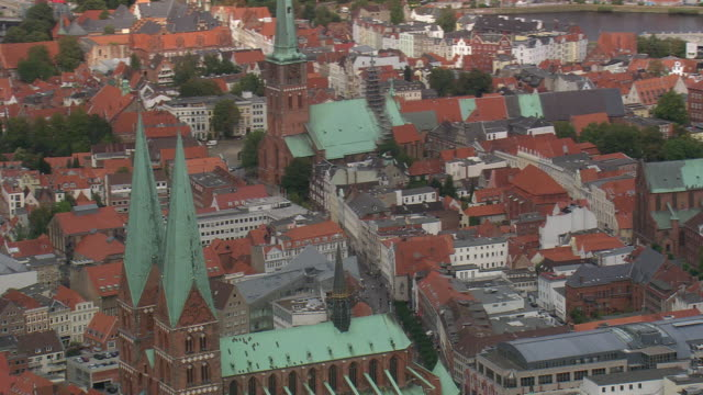 ms aerial shot of st. mary's church with other buildings at lubeck / germany - lübeck stock-videos und b-roll-filmmaterial