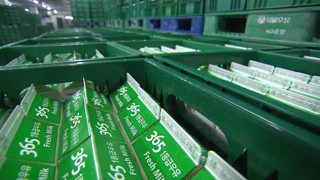 vidéos et rushes de shot of stacked milk boxes at storage. - brique