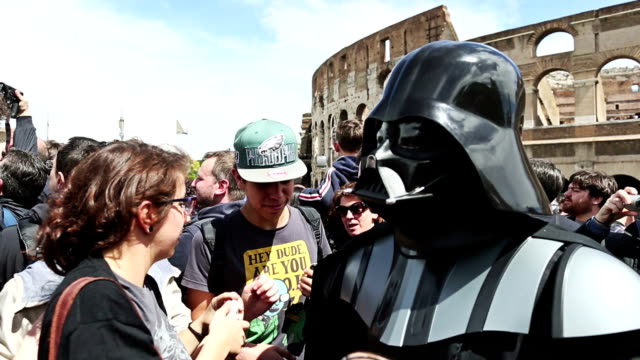 shot of star wars day 2014, a selfie with darth vader ,posing for photograph and interview with fans in front of coliseum / rome, italy - 自画像点の映像素材/bロール