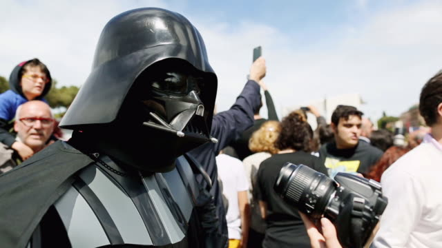 cu shot of star wars day 2014, darth vader posing for photograph and interview in front of coliseum / rome, italy - star wars stock videos & royalty-free footage