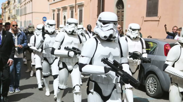ms shot of star wars day 2014, imperial guard walking in parade in streets / rome, italy - star wars stock videos & royalty-free footage
