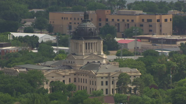 ms aerial ts shot of state capitol building / pierre, south dakota, united states - south dakota stock videos & royalty-free footage