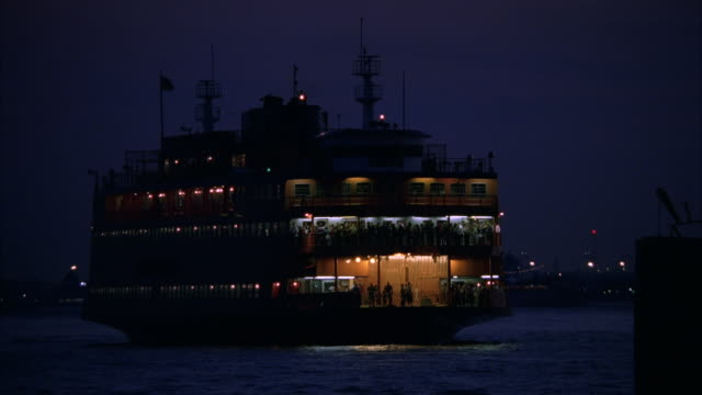 ms shot of staten island ferry on water / new york, new york, united states  - staten island stock videos and b-roll footage