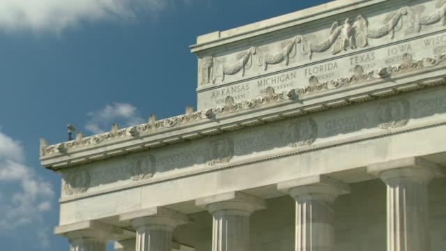 ms pan shot of states at top of lincoln memorial / washington, district of columbia, united states - レリーフ点の映像素材/bロール