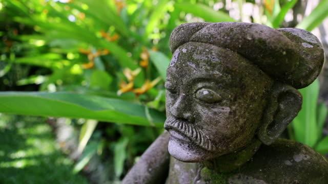 CU R/F Shot of statue in garden / Ubud, Bali, Indonesia