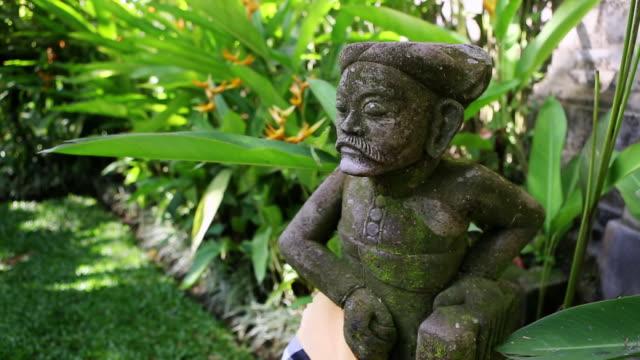 MS PAN Shot of statue in garden / Ubud, Bali, Indonesia