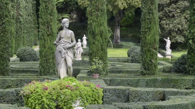ms shot of statue in giardino giusti botanical renaissance park / verona, veneto, italy - motion graphics stock videos & royalty-free footage