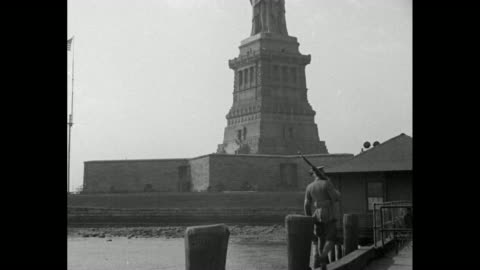 shot of statue of liberty / closer shot of statue, soldier on guard duty on dock in foreground / shot from below of statue / shot from inside torch... - statue of liberty new york city 個影片檔及 b 捲影像