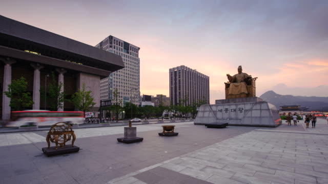 MS T/L Shot of statue of Sejongdaewang and sunset In Gwanghwamun / Seoul, South Korea