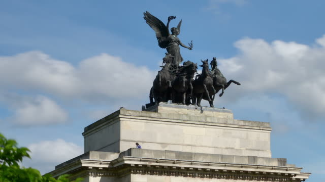 """MS ZI T/L Shot of Statue on Wellington arch Hyde Park Corner with clouds passing / London, Greater London, United Kingdom"""