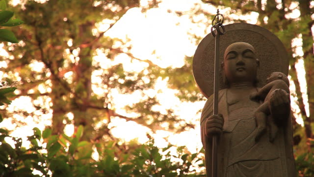 ms shot of statue / setagaya-ku, tokyo, japan - religion stock videos & royalty-free footage