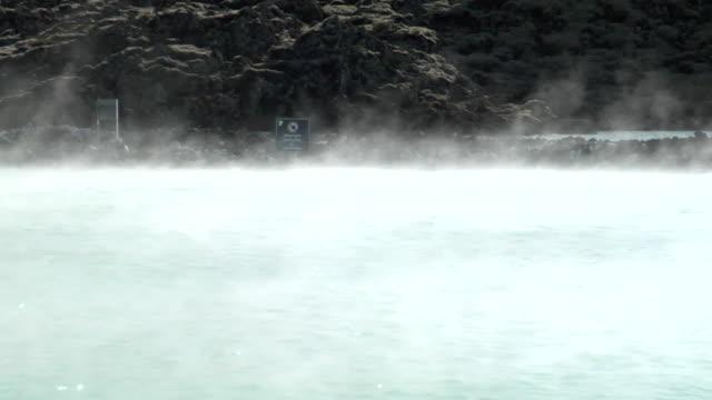 MS Shot of steam rolling off hot spring at resort / Reykjavik, Hofudhborgarsvaedhi, Iceland