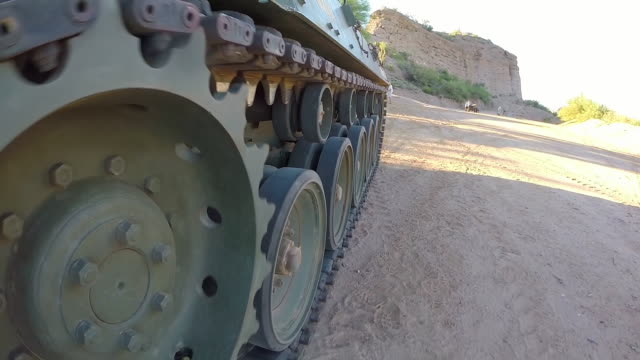 ecu pov shot of steel rollers moving m18 hellcat tank at shooting range / peoria, arizona, united states - armored tank stock videos and b-roll footage