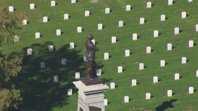 CU AERIAL DS ZO Shot of Sterling Price Monument at Springfield National Cemetery and tombstones / Springfield, Missouri, United States