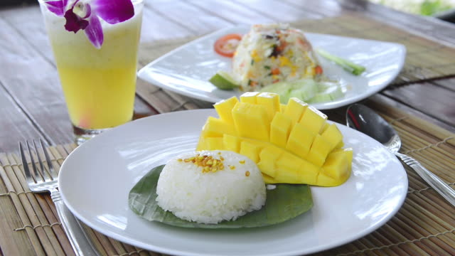 cu shot of sticky rice with mango, typical thai food dessert / island ko lanta, krabi province, thailand - ko lanta stock videos & royalty-free footage