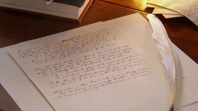 MS Shot of Still life of manuscript of Star Spangled Banner on desk with quill / Alexandria, Virginia, United States