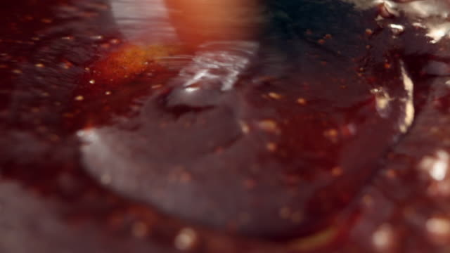 shot of stirring steak sauce on frying pan - thick stock videos & royalty-free footage
