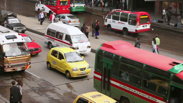 WS Shot of stop and go traffic on busy street / Bogota, Colombia