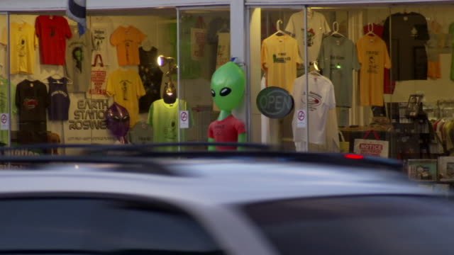 MS Shot of store window selling several alien related souvenirs in Roswell / Roswell, New Mexico, United States