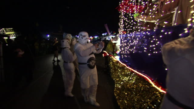 ms pov shot of storm troopers attack jedi float during roswell ufo festival parade / roswell, new mexico, united states - competition stock videos & royalty-free footage