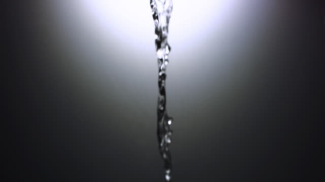 cu slo mo shot of stream of water falling from top of frame / united kingdom - stream body of water stock videos & royalty-free footage