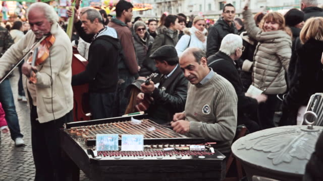 MS Shot of street artists entertaining tourists in Piazza Novena / Rome, Italy Gipsy band plays live music / Rome, Italy