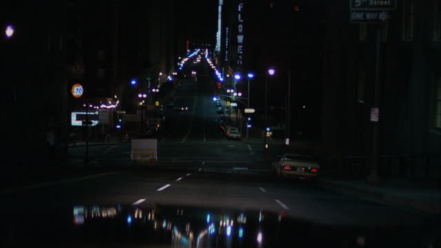 vídeos de stock, filmes e b-roll de ms pov shot of street at night / los angeles, california, united states - 1973