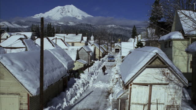 ms shot of street in small town in snow - 1972 stock videos and b-roll footage