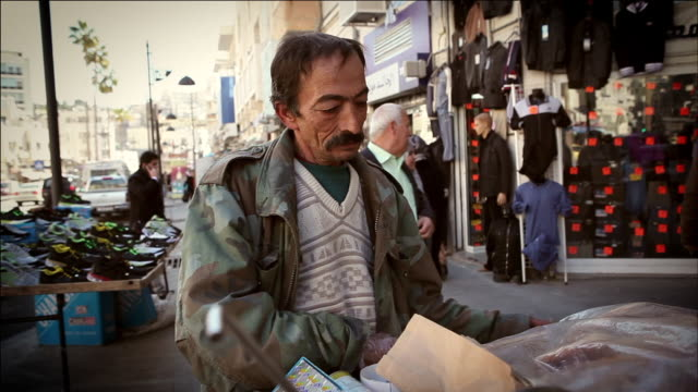 MS TD Shot of street vendor at amman city street / Amman, Jordan