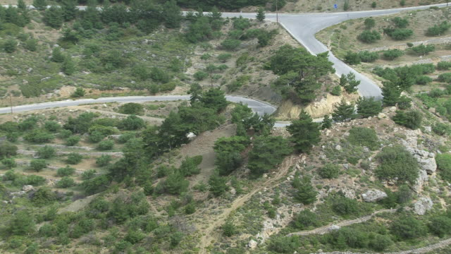 MS AERIAL PAN Shot of streets on mountain / Karpathos, Dodecanese, Greece