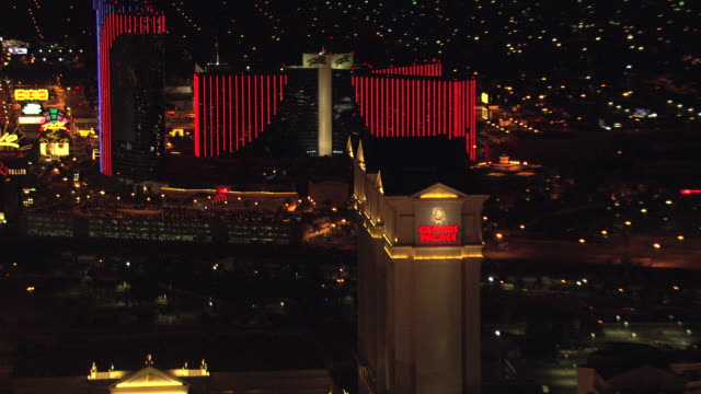 MS AERIAL TU ZI Shot of Strip downtown and Caesars Palace building with neon lights / Las Vegas, Nevada, United States