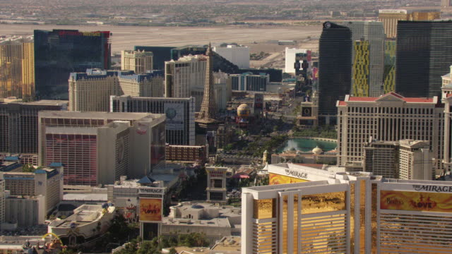 MS AERIAL Shot of Strip with casinos and hotels with Eiffel Tower downtown / Las Vegas, Nevada, United States