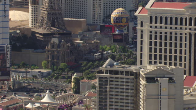 CU AERIAL Shot of Strip with casinos and hotels with Eiffel Tower in downtown / Las Vegas, Nevada, United States