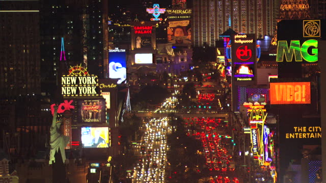 MS AERIAL TU Shot of Strip with marquees and Eiffel Tower with Trump hotel / Las Vegas, Nevada, United States