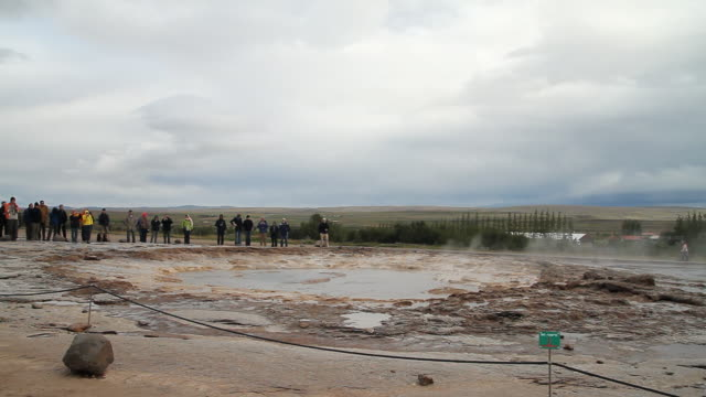 ms shot of strokkur geyser erupting / porvaldseyri, sudhurland, iceland  - wiese stock videos & royalty-free footage
