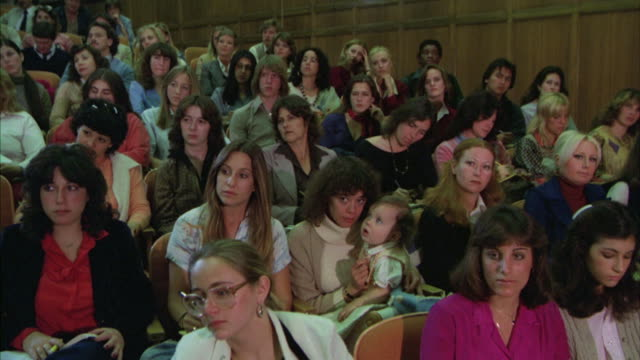 MS Shot of Students in audience listening and taking note at college or university lecture hall