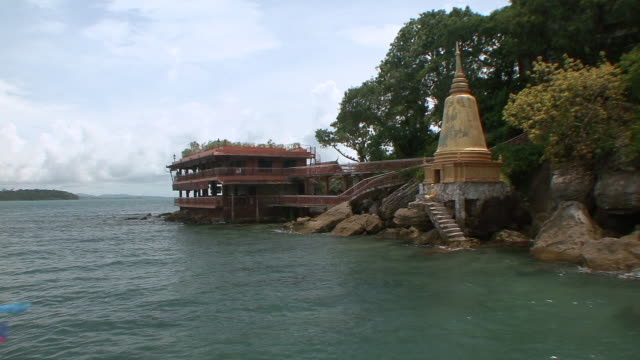 ws shot of stupa at private island on edge of water / sihanoukville, cambodia - stupa stock videos & royalty-free footage