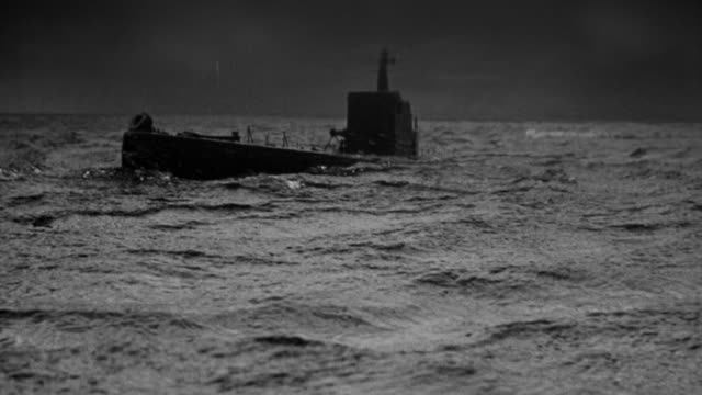 ms shot of submarine emerges moving in ocean - submarine stock videos and b-roll footage