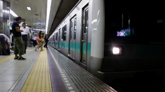 ms shot of subway train arriving at station / tokyo, japan - subway station stock videos & royalty-free footage