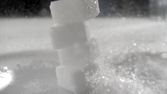 ECU SLO MO Shot of sugar cube falling down on sugar/ Seoul, South Korea