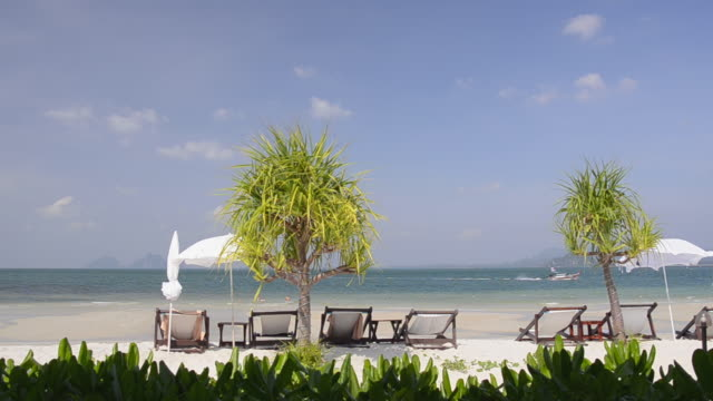 WS Shot of Sun chairs at sandy beach, hat chao mai marine national park / Ko Mook, Trang, Thailand