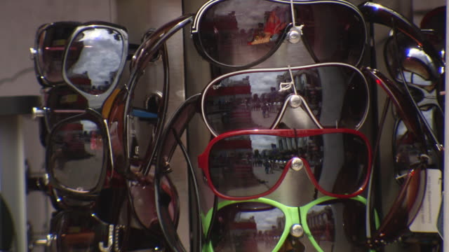 CU Shot of Sun glasses stall on city street / Bangalore, India